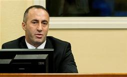 Kosovo's former Prime Minister and former commander of the Kosovo Liberation Army Ramush Haradinaj attends the verdict reading in his retrial at the International Criminal Tribunal for the former Yugoslavia in The Hague November 29, 2012. REUTERS/Koen van Weel/Pool