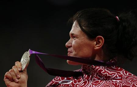 Silver medallist Russia's Darya Pishchalnikova poses at the women's discus throw victory ceremony during the London 2012 Olympic Games at the Olympic Stadium August 4, 2012. REUTERS/Eddie Keogh