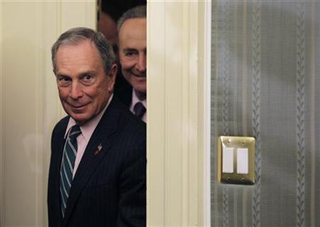New York City Mayor Michael Bloomberg (L) and Senator Charles Schumer (D-NY) arrive at a joint news conference on the Hurricane Sandy Federal Aid Request on Capitol Hill in Washington, November 28, 2012. REUTERS/Yuri Gripas (