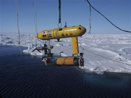 A free-swimming robot submarine, which is carried aboard the Australian Antarctic Division's icebreaker, Aurora Australis, is suspended from a crane in Eastern Antarctica in this September 26, 2012 handout picture made available to Reuters on October 11, 2012. REUTERS/Australian Antarctic Division/Handout