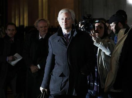 WikiLeaks founder Julian Assange leaves the Supreme Court at the end of the second day of his extradition appeal, in London February 2, 2012. REUTERS/Luke MacGregor/Files