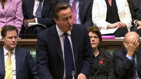 Britain's Prime Minister David Cameron, flanked by Deputy Prime Minister Nick Clegg (L), Culture Secretary Maria Miller (2ndR) and Business Secretary Vince Cable (R), speaks about Lord Justice Brian Leveson's report on media practices in Parliament in this still image taken from video in London November 29, 2012. REUTERS/UK Parliament/Pool