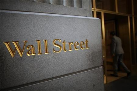 A sign is seen on Wall Street near the New York Stock Exchange June 15, 2012. REUTERS/Eric Thayer/Files