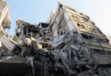 A general view of a building damaged by an air strike at a besieged area in Homs November 28, 2012. Picture taken November 28, 2012. REUTERS/Yazan Homsy