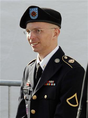 Army Private First Class Bradley Manning is escorted in handcuffs as he leaves the courthouse in Fort Meade, Maryland June 6, 2012. REUTERS/Jose Luis Magana