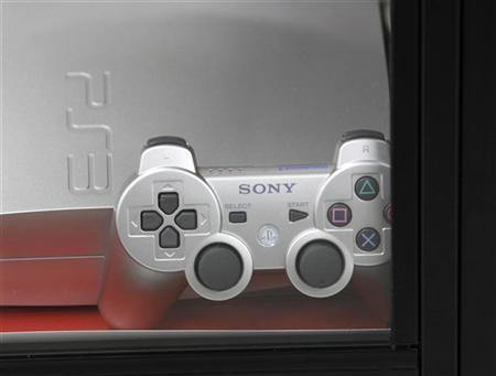 Sony's Playstation3 and its game controller are displayed at a showcase at an electronic shop in Tokyo May 1, 2011. REUTERS/Kim Kyung-Hoon