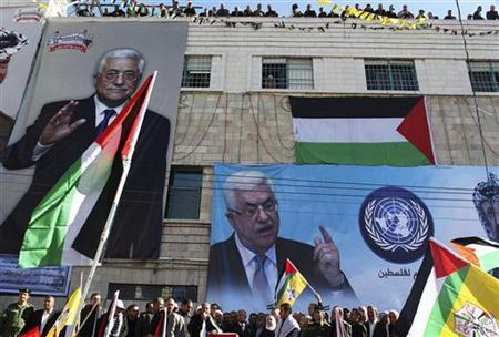 Banners depicting Palestinian President Mahmoud Abbas cover a wall during a rally in the West Bank city of Hebron, supporting the resolution that would change the Palestinian Authority's United Nations observer status from ''entity'' to ''non-member state'' November 29, 2012. REUTERS/Ammar Awad