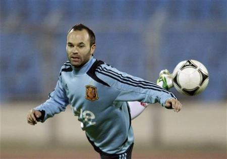 Spain's Andres Iniesta attends a training session at the Dinamo stadium in Minsk, October 11, 2012. REUTERS/Vasily Fedosenko/Files