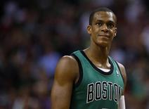 Boston Celtics guard Rajon Rondo waits during a free throw attempt in the second half of their NBA basketball game against the Oklahoma City Thunder in Boston, Massachusetts November 23, 2012. REUTERS/Brian Snyder