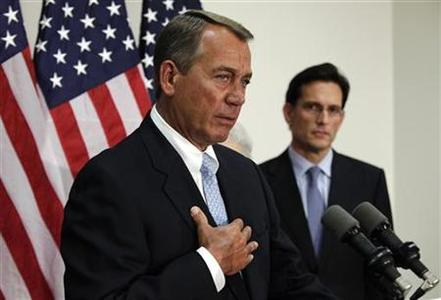 U.S. House Speaker John Boehner (R-OH) speaks next to Majority Leader Eric Cantor (R-VA) during a news conference on Capitol Hill in Washington, November 28, 2012. REUTERS/Yuri Gripas