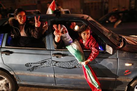 Palestinians celebrate on a street in Gaza City November 30, 2012. REUTERS/Mohammed Salem