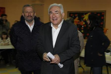 Former IMF head Dominique Strauss-Kahn leaves after casting his vote at a polling station in the second round of the 2012 French presidential elections in Sarcelles May 6, 2012. REUTERS/Gonzalo Fuentes/Files