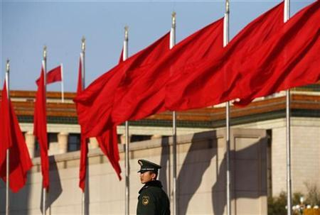 A paramilitary police officer stands guard at Tiananmen Square, outside the Great Hall of the People in Beijing November 14, 2012. REUTERS/David Gray