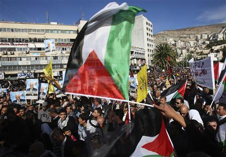People wave Palestinian flags during a rally in the West Bank city of Nablus, supporting the resolution that would change the Palestinian Authority's United Nations observer status from ''entity'' to ''non-member state'' November 29, 2012. REUTERS/Abed Omar Qusini