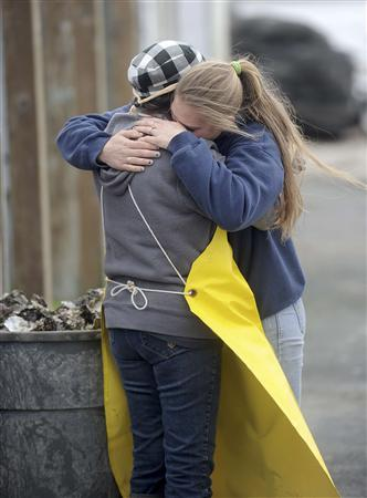 Jinny Lunny (R), whose father owns Drakes Bay Oyster Company, notifies a 27-year-old farm employee that the government will not renew her family's lease in Inverness, California, November 29, 2012. The U.S. government sided with environmental groups on Thursday with its decision to shut down a Northern California oyster farm in an attempt to restore wilderness. Secretary of Interior Ken Salazar said he would not renew the lease for the weatherbeaten shacks, oyster shell mounds and waterlogged docks that make up Drakes Bay Oyster Company. REUTERS/Noah Berger