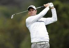 Nick Watney of the U.S. hits his approach shot to the 18th green during the first round of the World Challenge golf tournament in Thousand Oaks, California, November 29, 2012. REUTERS/Danny Moloshok