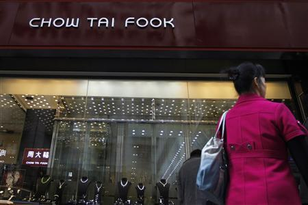 A woman walks past a Chow Tai Fook Jewellery store in Hong Kong in this December 15, 2011 file photo. Shares of Chow Tai Fook Jewellery Group Ltd, the world's biggest jewellery retailer by market value, fell more than five percent on November 30, 2012 after posting a disappointing slump in six-month profit due to slower sales and hedging loss. The stocks, which rose 5.4 percent on Thursday prior to the release of the earnings, fell to as low as HK$10.30, down 5.2 percent. That lagged a 0.2 percent gain in the benchmark Hang Seng Index. REUTERS/Tyrone Siu/Files