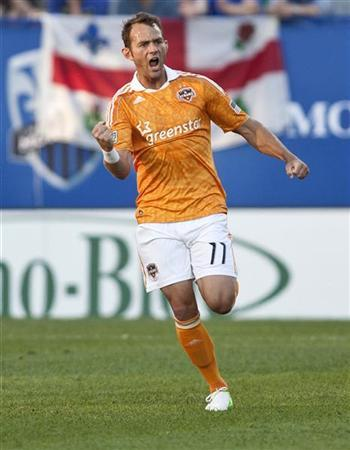 Houston Dynamo midfielder Brad Davis (11) celebrates after scoring against Montreal Impact during the first half of their MLS soccer match in Montreal June 23, 2012. REUTERS/Olivier Jean