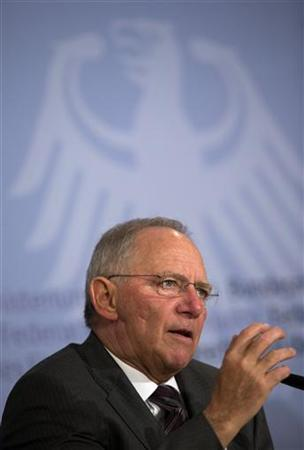 German Finance Minister Wolfgang Schaeuble speaks during a news conference in Berlin November 27, 2012. Germany's legal reservations about a further write-down of Greek public debt would cease to apply if the country were to reach a sustainable primary budget surplus, Schaeuble said on Tuesday. REUTERS/Thomas Peter (GERMANY - Tags: POLITICS BUSINESS)