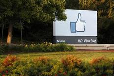 The sun sets on the entrance sign at Facebook's headquarters in Menlo Park, California, the night before the company's IPO launch, May 17, 2012. REUTERS/Beck Diefenbach (UNITED STATES - Tags: BUSINESS LOGO)