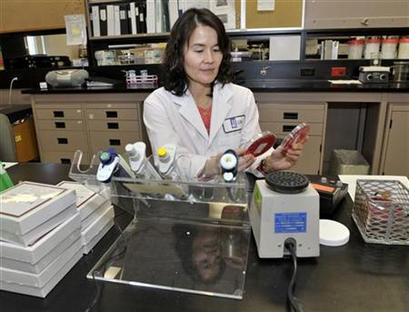Dr. Christine Lee, an infectious disease physician, poses in a lab at St. Joseph's Healthcare (hospital) at McMaster University in Hamilton, Ontario, November 22, 2012. REUTERS/Mike Cassese