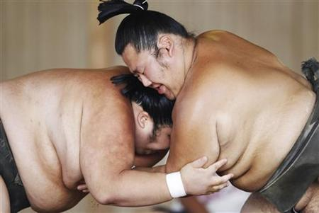 Sumo wrestlers train during a summer camp at a freshly rebuilt stable in Soma, in Fukushima prefecture, northern Japan August 6, 2011. REUTERS/Yuriko Nakao