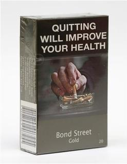 Photo illustration of a new mandatory package for cigarettes sold in Australia November 29, 2012. Australia's new stringent anti-tobacco laws, the most Draconian in the world, strips packs of all branding, bright colours and logos, leaving only the name printed in identical small font. Photo taken November 29, 2012. REUTERS/Tim Wimborne