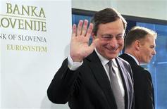 European Central Bank President Mario Draghi (C) waves after a news conference after the Governing Council Meeting of the European Central Bank in Brdo near Kranj, October 4, 2012. REUTERS/Srdjan Zivulovic