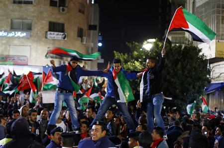 Palestinians celebrate as they take part in a rally in the West Bank city of Ramallah November 29, 2012. The 193-nation U.N. General Assembly overwhelmingly approved a resolution on Thursday to upgrade the Palestinian Authority's observer status at the United Nations from ''entity'' to ''non-member state,'' implicitly recognizing a Palestinian state. REUTERS/Marko Djurica