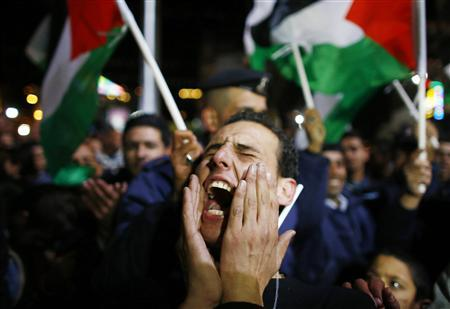 A Palestinian man shouts slogans during a rally in the West Bank city of Ramallah November 29, 2012. The 193-nation U.N. General Assembly overwhelmingly approved a resolution on Thursday to upgrade the Palestinian Authority's observer status at the United Nations from ''entity'' to ''non-member state,'' implicitly recognizing a Palestinian state. REUTERS/Marko Djurica