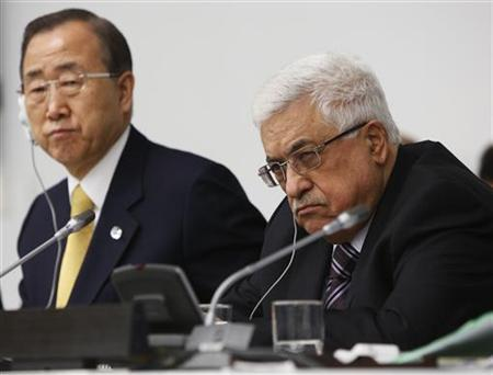 Palestinian President Mahmoud Abbas (R) and United Nations Secretary General Ban Ki-moon, listen during the Special Meeting of the Committee on the Exercise of the Inalienable Rights of the Palestinian People, in observance of the International Day of Solidarity with the Palestinian People, at the U.N. headquarters in New York, November 29, 2012. REUTERS/Chip East