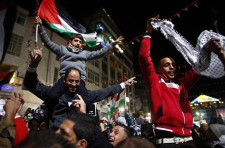 Palestinians shout slogans during a rally in the West Bank city of Ramallah November 29, 2012. Palestinian President Mahmoud Abbas appealed to the U.N. General Assembly to recognize Palestinian statehood by supporting a resolution to upgrade the U.N. observer status of the Palestinian Authority from ''entity'' to ''non-member state.'' REUTERS/Marko Djurica