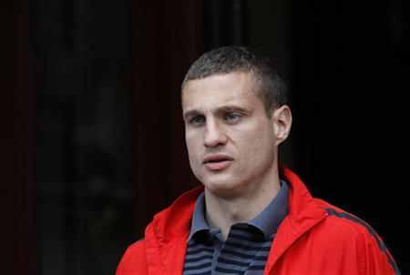 Manchester United's Nemanja Vidic leaves his hotel in London May 29, 2011. REUTERS/Suzanne Plunkett/Files