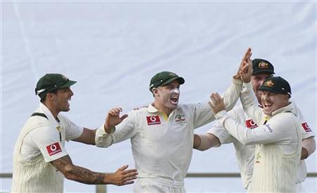 Teammates congratulate Australia's Mike Hussey (C) after he caught out South Africa's Vernon Philander during the first day's play of their third cricket test match at the WACA in Perth November 30, 2012. REUTERS/Stringer