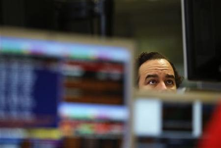 A trader looks at computer screens during a Spanish bond auction in Madrid November 8, 2012. ThursdayREUTERS/Andrea Comas/Files