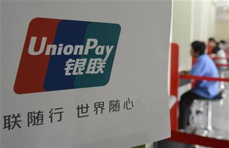The logo of the China UnionPay is seen at a bank in Taiyuan, Shanxi province July 20, 2012. REUTERS/Stringer (CHINA - Tags: BUSINESS)