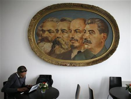 A man works on a laptop in a cafe of the newly opened Museum of Socialist Art in Sofia September 19, 2011. REUTERS/Stoyan Nenov/Files