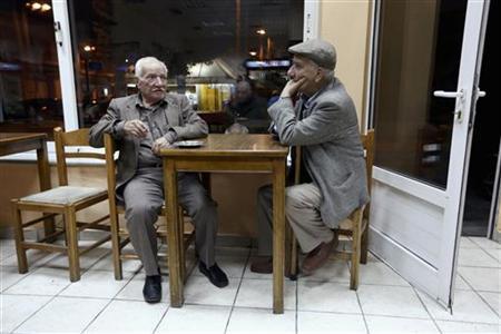 Greek pensioners sit at a traditional cafe at suburb of Egaleo in Athens November 12, 2012. REUTERS/Yorgos Karahalis