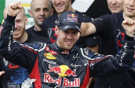 Red Bull Formula One driver Sebastian Vettel of Germany celebrates winning the world championship after the Brazilian F1 Grand Prix at Interlagos circuit in Sao Paulo November 25, 2012. REUTERS/Paulo Whitaker