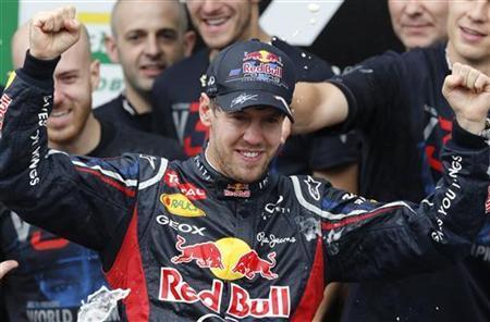 Red Bull Formula One driver Sebastian Vettel of Germany celebrates winning the world championship after the Brazilian F1 Grand Prix at Interlagos circuit in Sao Paulo November 25, 2012. REUTERS/Paulo Whitaker