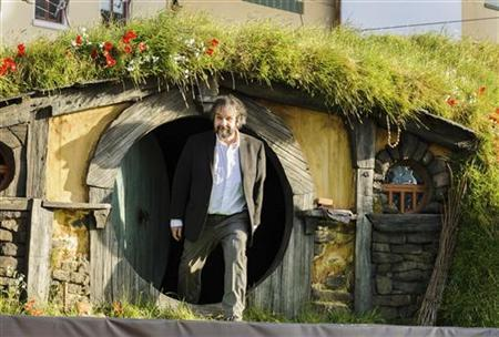 New Zealand director Peter Jackson emerges from a 'Hobbit Hole' to make an address at the world premiere of 'The Hobbit - An Unexpected Journey' in Wellington November 28, 2012. REUTERS/Mark Coote