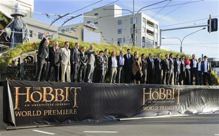New Zealand director Peter Jackson (9th from L) and cast members pose on a stage at the world premiere of 'The Hobbit - An Unexpected Journey' in Wellington November 28, 2012. REUTERS/Mark Coote