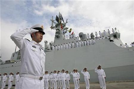 Sailors salute during a ceremony held before a Chinese naval fleet including two destroyers and a supply ship from the South China Sea Fleet set off from Sanya, Hainan province December 26, 2008. REUTERS/China Daily