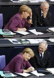 A combination of two images shows German Chancellor Angela Merkel and Finance Minister Wolfgang Schaeuble before a vote on financial help for Greece at the lower house of parliament, the Bundestag, in Berlin November 30, 2012. REUTERS/Wolfgang Rattay (GERMANY - Tags: POLITICS BUSINESS)