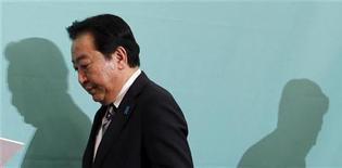 O primeiro-ministro do Japão, Yoshihiko Noda, que também é líder do Partido Democrático do Japão, é visto após debate para as eleições gerais em Tóquio. Noda adiou uma visita à Rússia prevista para o próximo mês alegando problemas de saúde do presidente russo, Vladimir Putin, informou a mídia japonesa nesta sexta-feira. 30/11/2012 REUTERS/Yuriko Nakao