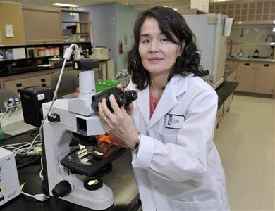 Dr. Christine Lee, an infectious disease physician, poses in a lab at St. Joseph's Healthcare (hospital) at McMaster University in Hamilton, Ontario, November 22, 2012. Drugmakers racing to develop medicines and vaccines to combat a germ that ravages the gut and kills thousands have a new challenger: the human stool. For patients hit hardest by the bacterium Clostridium difficile, also known as C. diff, getting a ''stool transplant'' could become a standard treatment within just a few years. Lee has more performed than 100 of the experimental procedure that is proving to be a godsend to patients. The five-minute bedside procedure cured the infection and prevented recurrences in 90 percent of patients, said Lee. Picture taken November 22, 2012. REUTERS/Mike Cassese