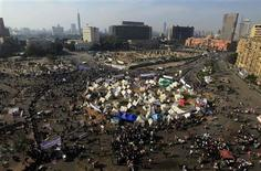 Protesters against President Mohamed Mursi are seen gathered in Tahrir Square in Cairo in this general view taken November 30, 2012. An Islamist-led assembly raced through approval of a new constitution for Egypt on Friday to end a crisis over Mursi's newly expanded powers, but opponents responded with another rally in Cairo against the Islamist leader. REUTERS/Mohamed Abd El Ghany