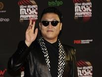 South Korean pop singer Psy poses on the red carpet as he attends the Mnet Asian Music Awards (MAMA) in Hong Kong November 30, 2012. REUTERS/Bobby Yip