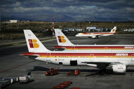 An Iberia airplane approaches two others parked on the tarmac at Madrid's Barajas airport November 29, 2012. REUTERS/Susana Vera