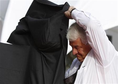 Hasso Plattner, co-founder of software giant SAP puts on his jacket as he arrives for a gala to celebrate the 40th anniversary of the founding of SAP in Mannheim April 29, 2012. REUTERS/Ralph Orlowski/Files